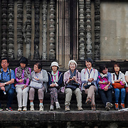 Tourist and others gather at temples in Angkor Wat, Cambodia.