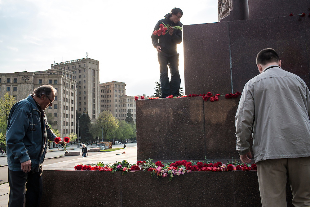 KHARKIV, UKRAINE - APRIL 22: Pro-Russian, pro-Communist, and other individuals lay flowers at the base of a statue of Russian revolutionary leader Vladimir Lenin on Freedom Square on what would have been his 144th birthday on April 22, 2014 in Kharkiv, Ukraine. Pro-Russian activists have been occupying government buildings and demanding greater autonomy in many Eastern Ukrainian cities in recent weeks. (Photo by Brendan Hoffman/Getty Images) *** Local Caption ***
