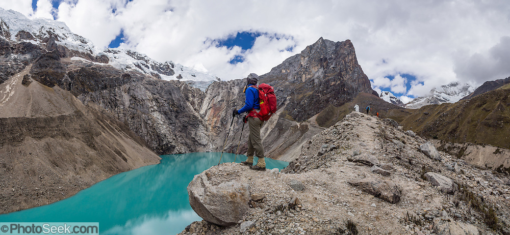 The turquoise waters of Jancarurish Lake are colored by glacial flour from Nevado Alpamayo (19,511 ft or 5947 m), in Alpamayo Valley, Cordillera Blanca, Andes Mountains, Peru, South America. Day 7 of 10 days trekking around Alpamayo, in Huascaran National Park (UNESCO World Heritage Site). This panorama was stitched from 6 overlapping photos.