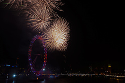 Westminster, London, January 1st 2015. 100,000 ticket-holders crowd London's embankment and other vantage points as a spectacular firework display beginning on the stroke of midnight welcomes in the new year.The world-renowned displayfeatures 12,000 fireworks producing 50,000 projectiles, fired from three fireworks barges moored in the River Thames.