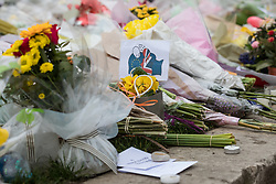 © Licensed to London News Pictures. 29/03/2017. London, UK. A card showing an EU figure hugging a Union Jack figure is seen among flowers left in Parliament Square for the victims of the Westminster terrorist attack. Photo credit: Rob Pinney/LNP