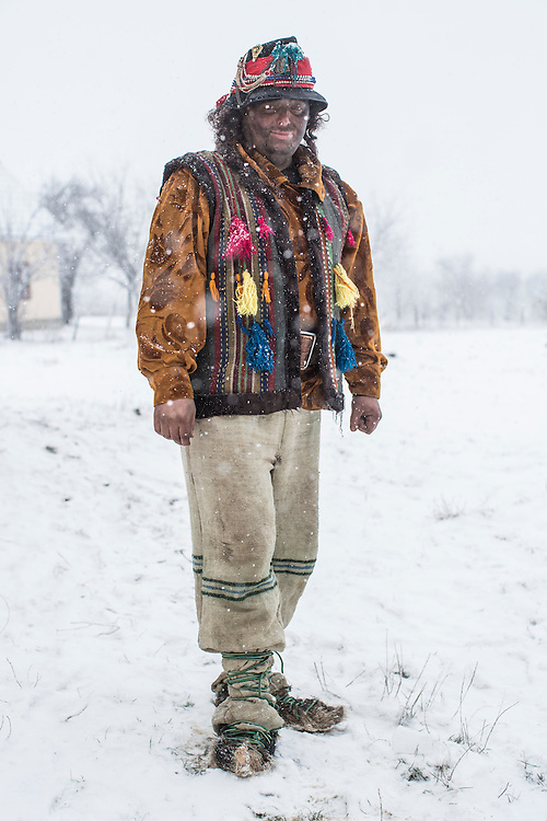 Vasyl Pleshka, 30, dressed in the costume of a gypsy, poses for a portrait during celebrations of the Malanka Festival on Thursday, January 14, 2016 in Krasnoilsk, Ukraine. The annual celebrations, which consist of costumed villagers going in a group from house to house singing, playing music, and performing skits, began the previous sundown, went all night, and will last until evening.