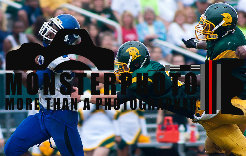 Dover Running Back Donovan Cain #21 carries the ball down the sidelines while St. Mark's defender try to make a tackle during a Week 3 high school football game against Dover late in the fourth quarter Saturday afternoon Sept. 24, 2011 in Wilmington DE.<br /> <br /> The News Journal/Saquan Stimpson