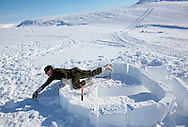 Canadian soldiers train to build an igloo..A small 2 persons igloo could take two hours to complete by experienced Inuit.