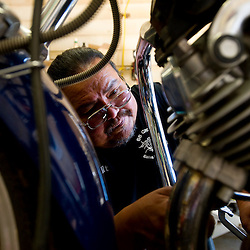 101211    Brian Leddy.Milt Garnanez, the head technician at 66 Cyclez, works on a Yamaha Virago motorcycle Wednesday at the shop. Garnanez said he has been working on bikes for over 25 years.