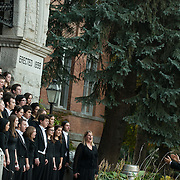 The choir practices on the steps of College Hall for an upcoming performance.<br />
