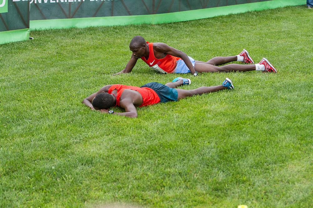 Beach to Beacon 10K: Bedan Karoki Muchiri, winner, lays in grass after finishing, with runner up Stephen Kosgei Kibet