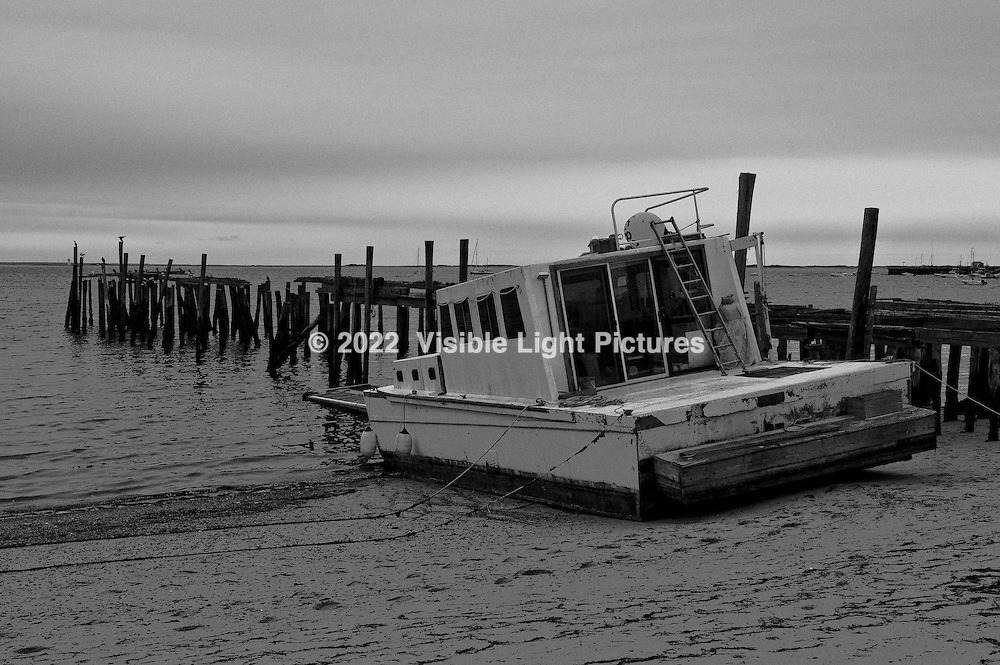 Houseboat grounded on beach in Provincetown, Cape Cod