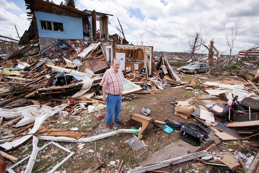 A man searches for his mother's former posessions after a tornado in Joplin, Missouri, May 25, 2011.  On May 22, 2011, Joplin Missouri was devastated by an EF-5 tornado.