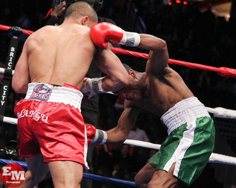 """April 9, 2011; Newark, NJ; USA; Eber Luis Perez (Green/White) and Jose """"Mangu"""" Peralta (Red) during their bout at the Prudential Center in Newark, NJ.  Peralta won via 3rd round TKO."""