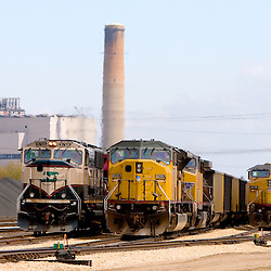 Coal trains from both western railroads, Union Pacific(UP) and Burlington Northern Santa Fe (BNSF), wait to be unloaded at the Commonwealth Edison power plant in Powerton, IL.