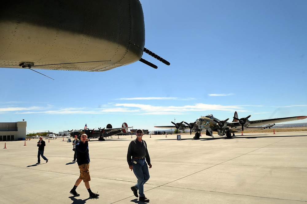 jt040517c/a sec/jim thompson/ Checking out the tail guns of a B-25J Mitchell on the Cutter Aviation tarmac as the four planes of the Wings of Freedom Tour is in Albuquerque Wednesday April 5th-7th.  April 05, 2017. (Jim Thompson/Albuquerque Journal)