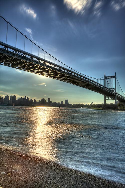 Tri-borough Bridge during a sunset.