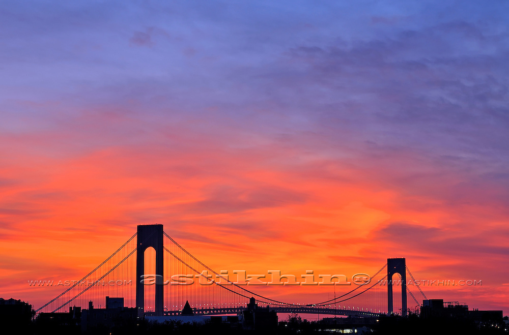 Silhouette of the Verrazano-Narrows Bridge on the Red Sunset Background.
