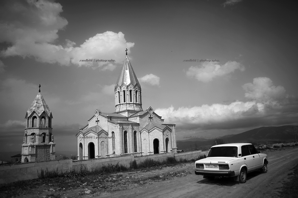 """Ghazanchetsots cathedral. This image is part of the photoproject """"The Twentieth Spring"""", a portrait of caucasian town Shushi 20 years after its so called """"Liberation"""" by armenian fighters. In its more than two centuries old history Shushi was ruled by different powers like armeniens, persians, russian or aseris. In 1991 a fierce battle for Karabakhs independence from Azerbaijan began. During the breakdown of Sowjet Union armenians didn´t want to stay within the Republic of Azerbaijan anymore. 1992 armenians manage to takeover """"ancient armenian Shushi"""" and pushed out remained aseris forces which had operate a rocket base there. Since then Shushi became an """"armenian town"""" again. Today, 20 yeras after statement of Karabakhs independence Shushi tries to find it´s opportunities for it´s future. The less populated town is still affected by devastation and ruins by it´s violent history. Life is mostly a daily struggle for the inhabitants to get expenses covered, caused by a lack of jobs and almost no perspective for a sustainable economic development. Shushi depends on donations by diaspora armenians. On the other hand those donations have made it possible to rebuild a cultural centre, recover new asphalt roads and other infrastructure. 20 years after Shushis fall into armenian hands Babies get born and people won´t never be under aseris rule again. The bloody early 1990´s civil war has moved into the trenches of the frontline 20 kilometer away from Shushi where it stuck since 1994. The karabakh conflict is still not solved and could turn to an open war every day. Nonetheless life goes on on the south caucasian rocky tip above mountainious region of Karabakh where Shushi enthrones ever since centuries."""