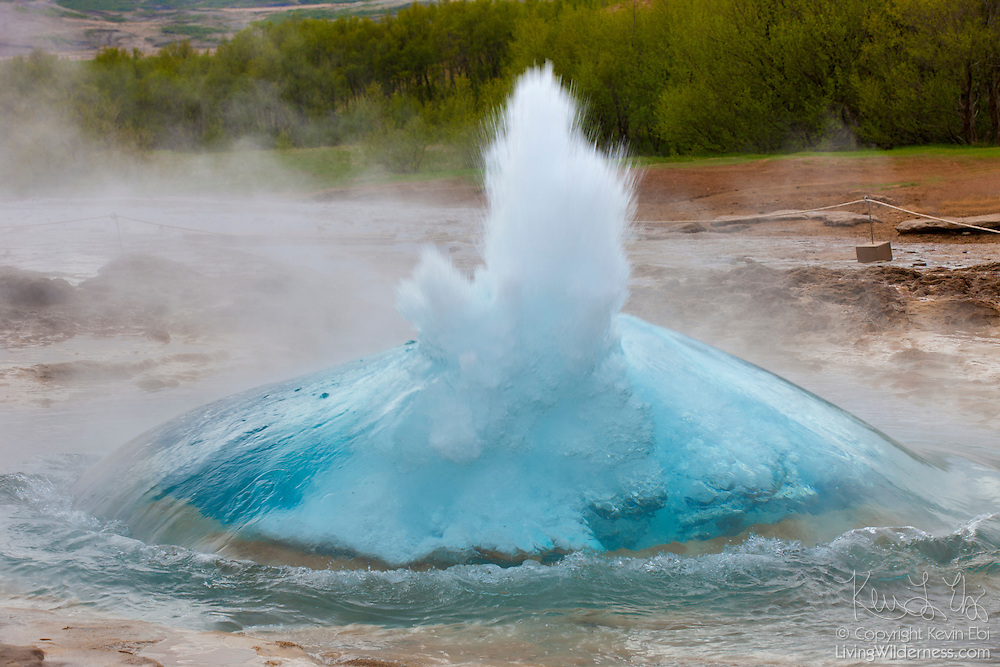 "The Icelandic geyser Strokkur begins to erupt. Strokkur means ""churning."" Its water level repeatedly swells and contracts before erupting, which it does every four to eight minutes. The geyser, which first erupted in 1789, reaches a height of as much as 100 feet (30 meters)."