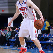 Grand Rapids Drive Guard Nate Wolters (21) dribbles the ball near the baseline the second half of a NBA D-league regular season basketball game between the Delaware 87ers and the Grand Rapids Drive (Detroit Pistons) Saturday, Apr. 04, 2015 at The Bob Carpenter Sports Convocation Center in Newark, DEL.