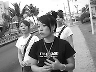 "Japanese tourists wearing ""I love Guam"" t-shirts walking in Tumon, Guam, on Saturday, Mar. 10, 2007.  Sometimes known as 'America in Asia', Guam is a popular destination for Japanese tourists ( accounting for approx 90% of the island's visitors) with average visitor numbers from Japan approaching 1million.  The island, a 3.5 hour flight from Japan, has more than 20 large hotels and numerous duty-free shopping malls catering to the Japanese tourists predilection for designer brand name goods, as well as golfing and other water based entertainment features. In 2007-2008 US military personal currently stationed in the Japanese Okinawan Islands will relocate their bases and operations  to Guam, helping to stabilise the island's economy which suffered after tourism decreased in recent years due to a  fear of flying by Japanese post 9-11 World Trade Centre disaster, a 2003 typhoon and the SARS disease outbreak in Asia."