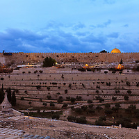 Pre-dawn view of Jerusalem's Dome of the Rock and Old City walls shortly before dawn. The Valley of Kidron, Absalom's Tomb and Mount of Olives cemetery are in the foreground.
