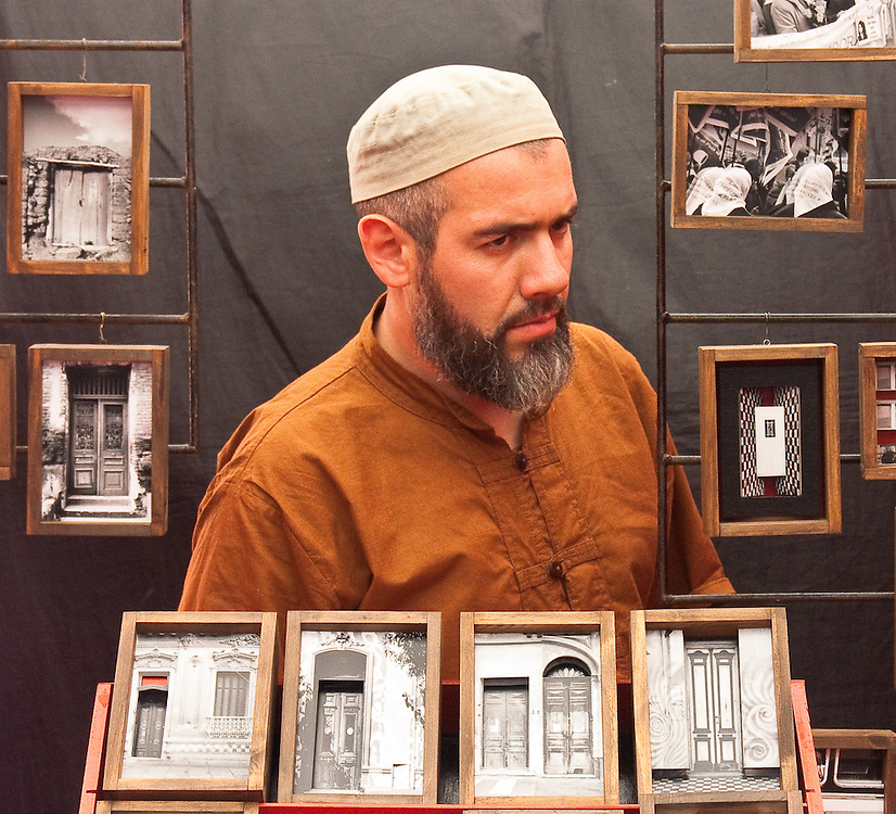 Framed by his own picture frames at the Sunday flea maket. Buenos Aires, Argentina.