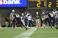 Mississippi running back Jeff Scott (3) vs. Vanderbilt in Nashville, Tenn. on Thursday, August 29, 2013.