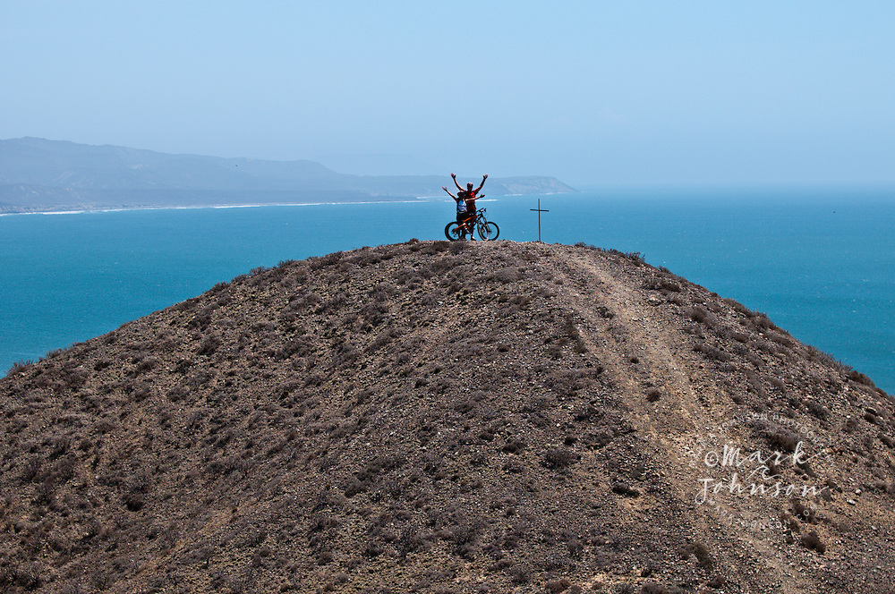 Couple mountain biking at Punto San Carlos, Baja California, Mexico