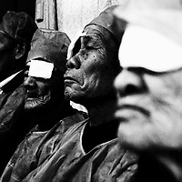"""CHONGZUO-APRIL 11: elderly farmers wait outside the  surgery in the """"Lifetime Express"""" train April 11, 2004 in Chongzhou, Guangxi province, China. Guangxi is one of the poorest places in China with an annual income of USD 120-250 per year for peasants. Without Lifetime Express, a Hong Kong based Non Governmental Organization (NGO) that performs cataract surgeries for free, many people in rural areas would remain partly blind as the official fee for such surgeries in China about USD 600 is out of reach for all of them."""