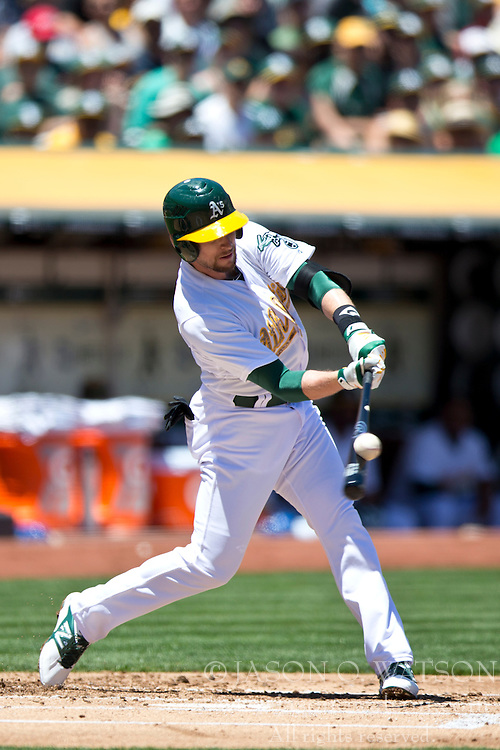 OAKLAND, CA - MAY 26:  Jed Lowrie #8 of the Oakland Athletics at bat against the Detroit Tigers during the first inning at O.co Coliseum on May 26, 2014 in Oakland, California. The Oakland Athletics defeated the Detroit Tigers 10-0.  (Photo by Jason O. Watson/Getty Images) *** Local Caption *** Jed Lowrie
