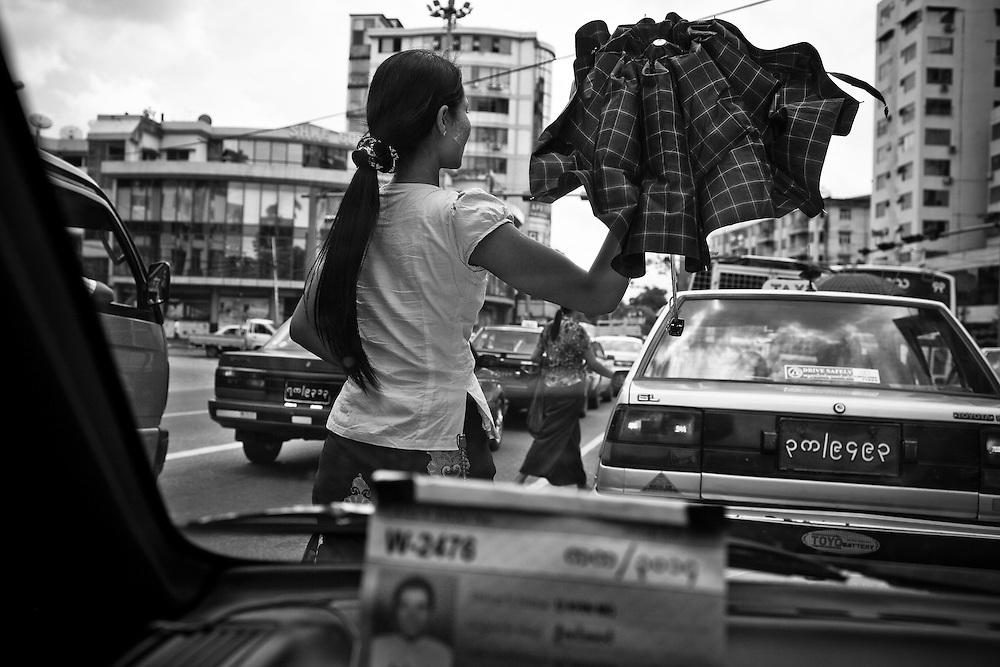 A street scene viewed through a taxi in Yangon, Myanmar.