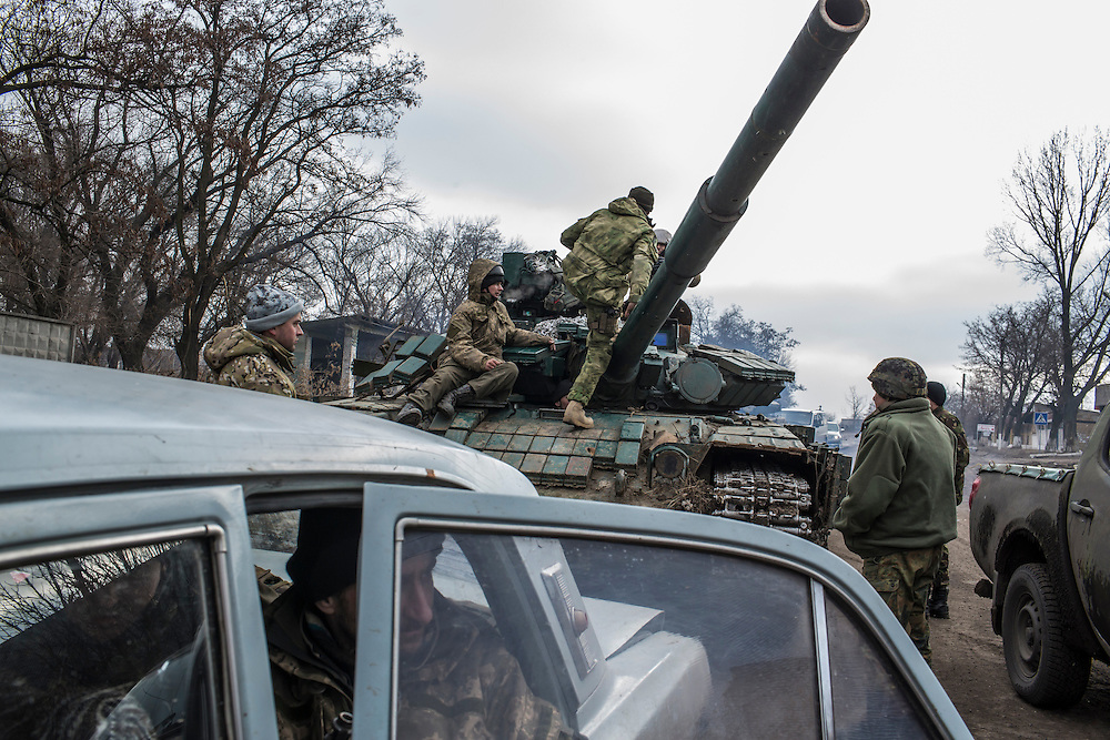 SVITLODARSK, UKRAINE - FEBRUARY 7, 2015: Ukrainian forces gather at a checkpoint in Svitlodarsk, Ukraine. The village is along the only road leading from the heavily-damaged town of Debaltseve, which is Ukrainian controlled but surrounded by rebel forces on three sides. CREDIT: Brendan Hoffman for The New York Times