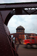 The bridge tender tower stands guard over the old lift bridge across the Calumet River at 100th St. on the south side of Chicago as a tractor trailer truck speeds across the structure.