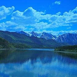 Mountains reflecting over a lake, Carcross, Yukon Territory, Canada