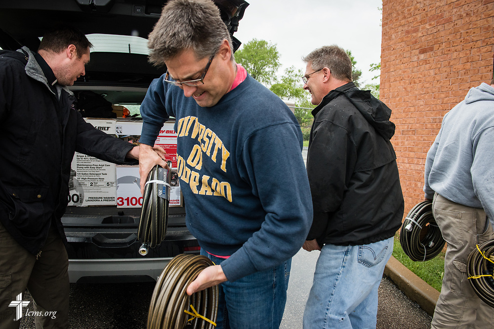 The Rev. Bob Liebmann, pastor of St. Mark's Lutheran Ministry, Eureka, Mo., helps carry supplies purchased for flood cleanup by the Rev. Michael Meyer, manager of LCMS Disaster Response (left), on behalf of LCMS Disaster Response, on Wednesday, May 4, 2017, at the parish in Eureka, Mo. LCMS Communications/Erik M. Lunsford