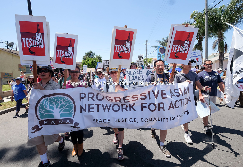 Thousands people participate in &quot;People's Climate March&quot; a climate change awareness march and rally, in Los Angeles, Saturday, April 29, 2017. The gathering was among many others of its kind held nationwide marking President Donald Trump's 100th day in office.(Photo by Ringo Chiu/PHOTOFORMULA.com)<br /> <br /> Usage Notes: This content is intended for editorial use only. For other uses, additional clearances may be required.