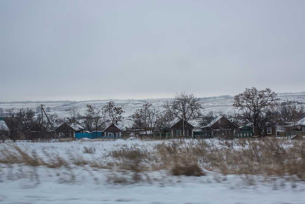 YURIVKA, UKRAINE - DECEMBER 8, 2014: Houses along the road near Yurivka, Ukraine. CREDIT: Brendan Hoffman for The New York Times