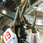 Erie BayHawks Forward Terrence Jennings (21) drives towards the basket as Delaware 87ers Forward Thanasis Antetokounmpo (19) and Delaware 87ers Forward Damian Saunders (18) defends in the second half of a NBA D-league regular season basketball game between the Delaware 87ers (76ers) and the Erie BayHawks (Knicks) Tuesday, Feb. 11, 2014 at The Bob Carpenter Sports Convocation Center, Newark, DE