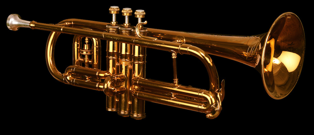 brass cornet at slight angle on black background with clipping path
