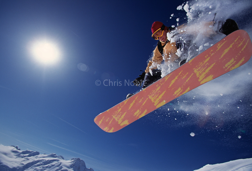 Jim Zellers takes flight while snowboarding on the Juneau Icefields in Southeast Alaska.