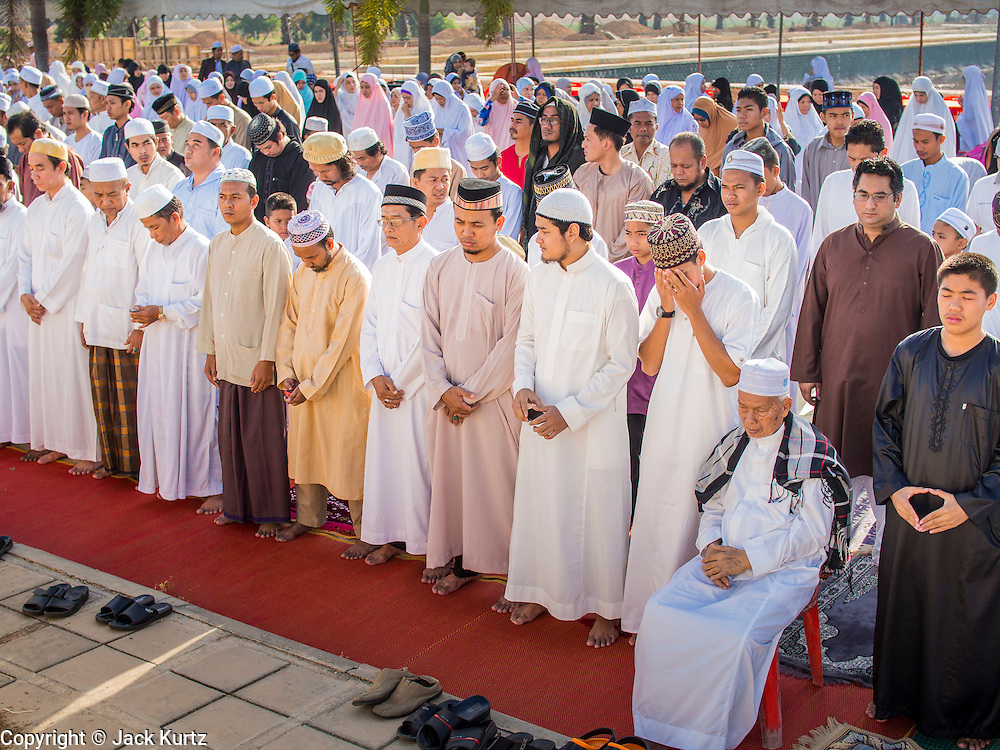 Men pray during Eid services at Songkhla Central Mosque in Songkhla province of Thailand. Eid al-Fitr is also called Feast of Breaking the Fast, the Sugar Feast, Bayram (Bajram), the Sweet Festival and the Lesser Eid, is an important Muslim holiday that marks the end of Ramadan, the Islamic holy month of fasting.