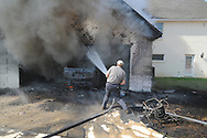 Lafayette County fireman Richard Shivers fights a house fire at 111 Eastwind Drive off of Highway 30 in Oxford, Miss. on Friday, September 17, 2010.