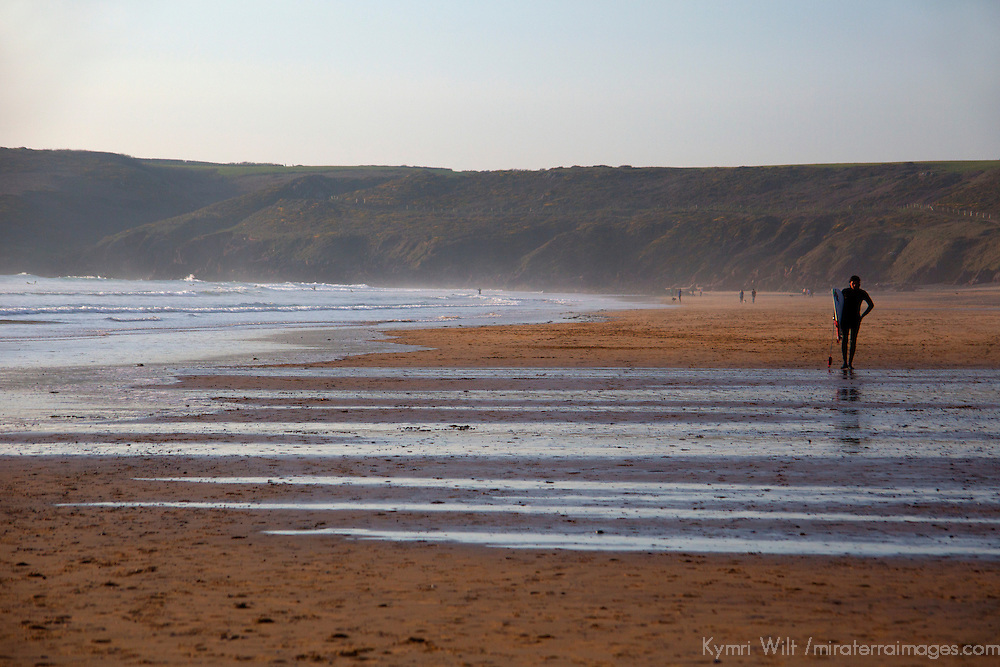 Europe, United Kingdom, Wales, Pembrokeshire. Surfer at Freshwater West Beach in Pembrokeshire.