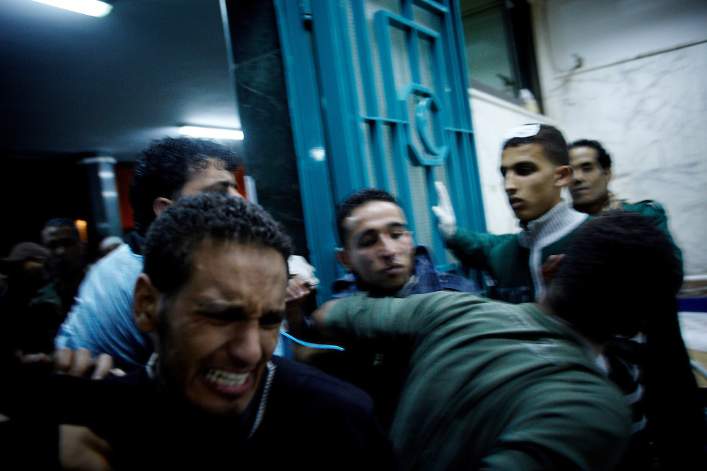 Benghazi, Libya, 04.03.11..At the Jalaa hospital a desperate man break through the door to look for his brother who is missing after the Rajma weapons storage explosion...Photo by: Eivind H. Natvig/MOMENT