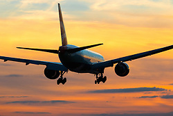 London Heathrow, September 19th 2015. A British Airways Boeing 777-300 lands on London Heathrow's Runway 27R as the sun sets.