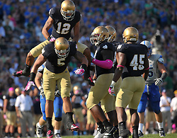 Cornerback Robert Blanton (12) celebrates with linebacker Manti Te'o (5) after a big stop against Air Force.