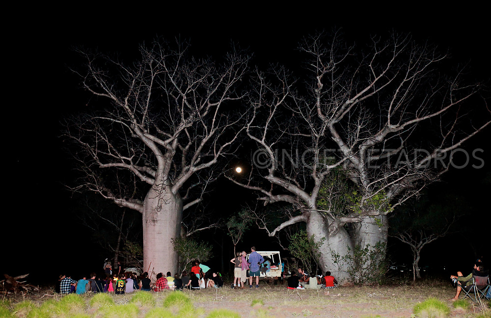 VIP's and Students of the Yiramalay/Wesley Studio School gathered with Bunuba elders in front of a large boab tree as they where invited for the burial of Bunuba remains in a repatriation ceremony at Dingo Gap on Tunnel Creek Road. Tunnel Creek. WA