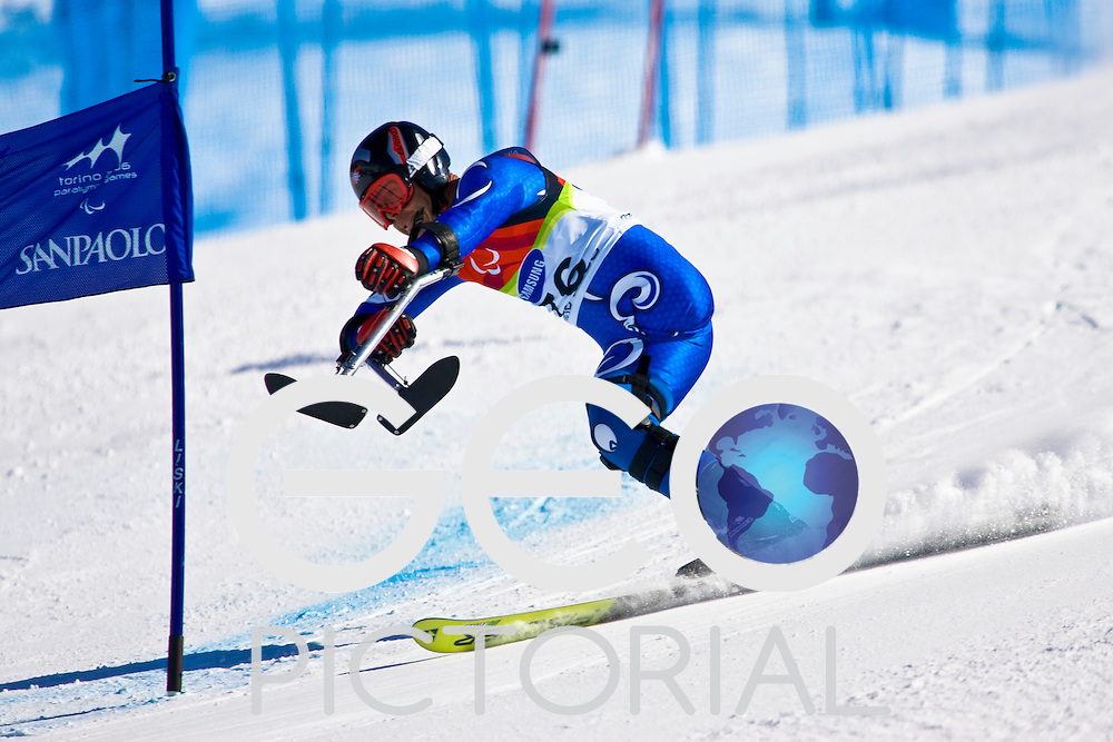 SESTRIERE COLLE, ITALY - MARCH  16th : Christian Lanthaler (LW2) of Italy on his first run of the Mens Alpine Skiing Giant Slalom Standing competition on Day 6 of the 2006 Turin Winter Paralympic Games on March 16th, 2006 in Sestriere Borgata, Italy.