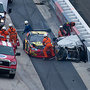 Ryan Truex climb over Clint Bowyer car after crashes on the final lap during the NASCAR Nationwide Series at Dover International Speedway in Dover Delaware...Carl Edwards went on to win the NASCAR Nationwide Series at Dover International Speedway in Dover Delaware...