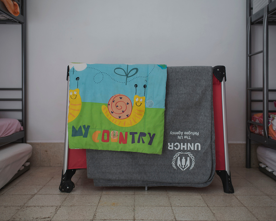 A child's cot bed in one of the rooms in Villa Artemis, a shelter for 30 refugee women and their children in the grounds of Leros Hospital. <br />