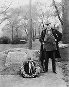 Sir Thomas J. Lipton, (1848-1931), the creator of the famous LIPTON TEA brand, next to memorial to David Kennison, last survivor of the Boston Tea Party. Ca. 1927.