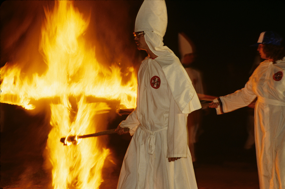 USA, Maryland, Rocky Ridge, Ku Klux Klan members gather around burning cross